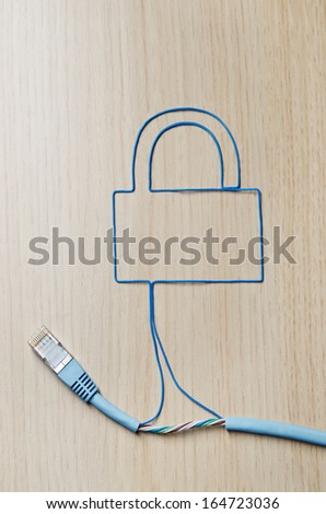 Network security. Blue ethernet cable shaping a padlock - stock photo