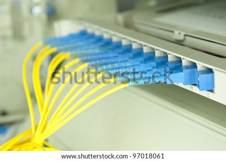 network server room routers and fiber optical cables - stock photo