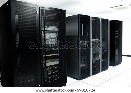 network server room with black servers - stock photo