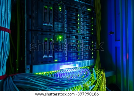 Network switch and UTP ethernet cables close-up in the server room - stock photo
