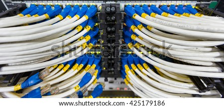 Network switch with Lan cable mount on rack in data center  - stock photo