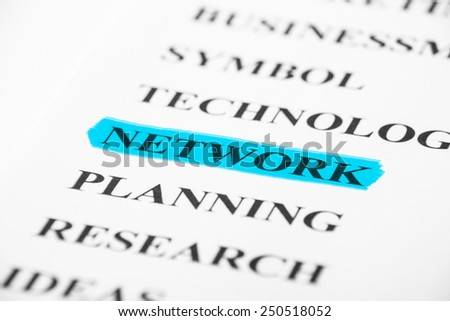 Network with some other related words on paper. - stock photo