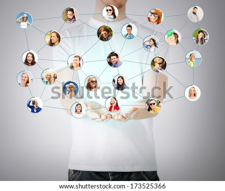 networking and communication concept - closeup of mans hands showing social network - stock photo