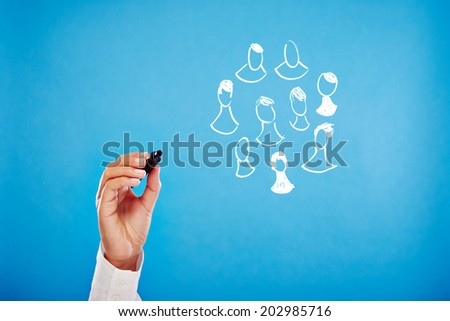 Networking - Business hand on blue background sketching - stock photo