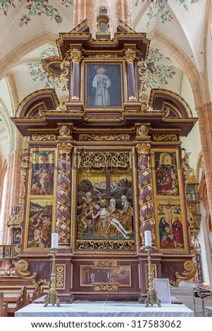 NEUBERG AN DER MURZ, AUSTRIA - SEPTEMBER 13, 2015: The side carved polychrome early baroque altar completed in year 1668 with the Deposition (Pieta) in the center in Dom of Neuberg by unknown artist . - stock photo