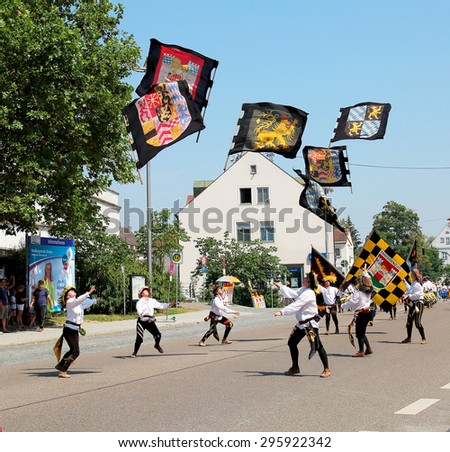 NEUBURG AN DER DONAU-JULY 5:juggler march at Schlossfest on July 5,2015 in Neuburg, Germany. This traditional historic festival takes place every two years, historic dressed people walk in the city.  - stock photo