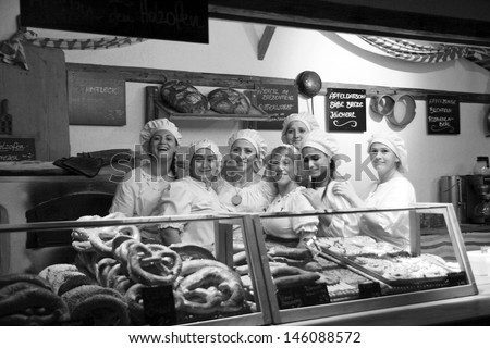 NEUBURG AN DER DONAU - JUNE 30:colleagues of bakery at  traditional German medieval festival on June 30, 2013 in Neuburg, Germany. This is annually festival in city Neuburg in Bavaria, Germany - stock photo