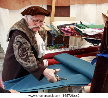 NEUBURG AN DER DONAU - JUNE 30:tailor in traditional German medieval costum at the festival on June 30, 2013 in Neuburg, Germany. This is annually festival in Neuburg in Bavaria, Germany - stock photo