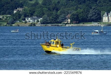 NEUCHATEL, SWITZERLAND, AUG 3 : unidentified men in rescue boat on the lake in Neuchatel, Switzerland, on August 3 2013. - stock photo