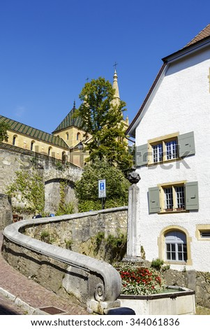 NEUCHATEL, SWITZERLAND - SEPTEMBER 09, 2015: The picturesque corner at narrow street leading to the castle hill in the city with a population of approx. 34000 mainly French-speaking citizens - stock photo
