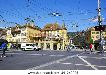 NEUCHATEL, SWITZERLAND - SEPTEMBER 09, 2015: Urban scene, view of tram system infrastructure at crossroad in the city with a population of approx. 34000 mainly French-speaking residents - stock photo