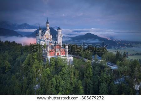 Neuschwanstein Castle, Germany. Image of Neuschwanstein castle during foggy summer twilight. - stock photo