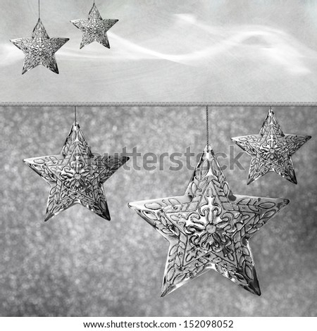 Neutral Grey Holiday Abstract Background With Silver Star Christmas Ornaments - stock photo