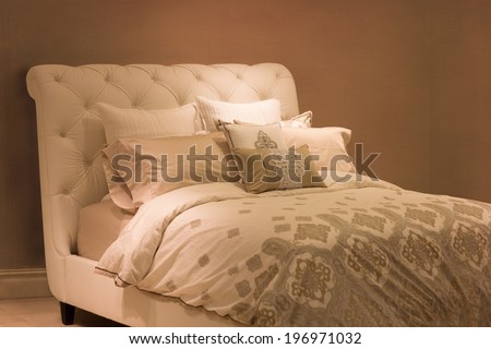 Neutral tone luxury bed - stock photo