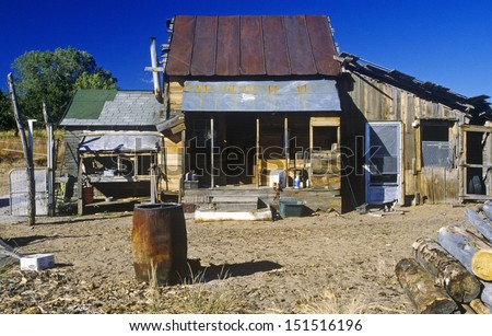 NEVADA - CIRCA 1980's: Old ramshackle dwelling with oil drum in dirt yard