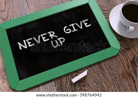 Never Give Up Handwritten on Green Chalkboard. Business Concept. Composition with Chalkboard and Cup of Coffee. Top View Image. 3D Render. - stock photo