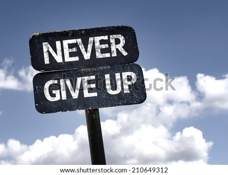 Never Give Up sign with clouds and sky background  - stock photo