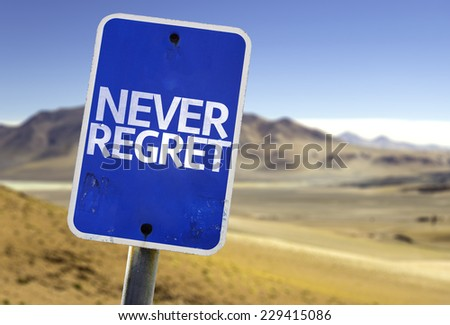Never Regret sign with a desert background - stock photo
