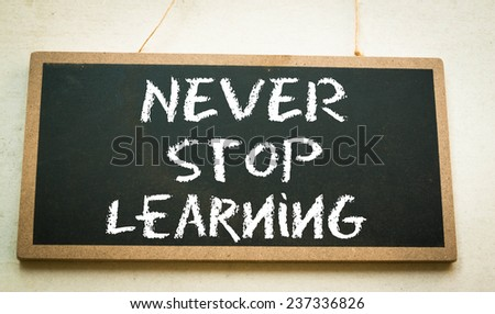 never stop learning text on board  - stock photo