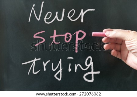 Never stop trying  words written on blackboard using chalk