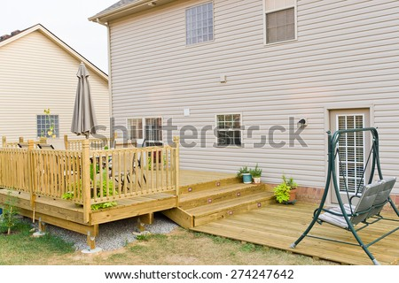 New above ground deck and patio of family home. - stock photo