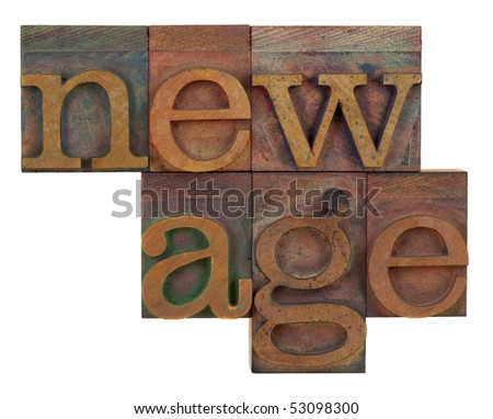 new age in vintage wood letterpress type, stained by color ink, isolated on white - stock photo