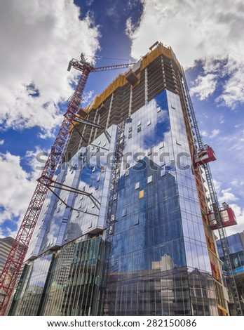 New all glass building construction site - stock photo