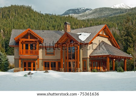 New american dream home with a beautiful mountains in background - stock photo