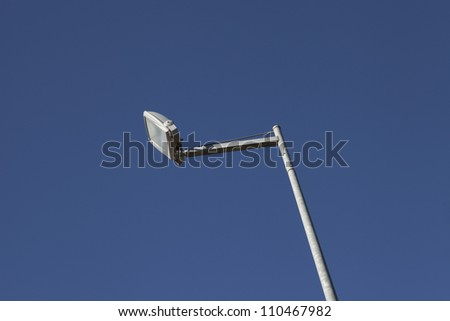 New and contemporary streetlight. Photographed on blue background - stock photo