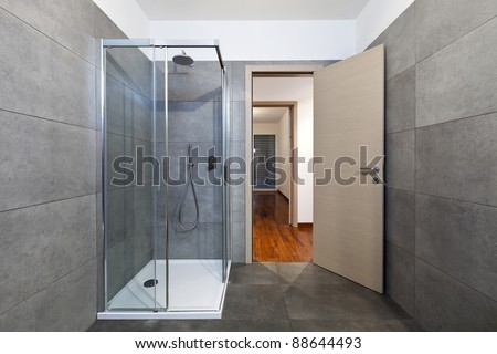 new apartment, bathroom shower cabin - stock photo