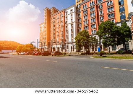 New apartment building in suburban area - stock photo