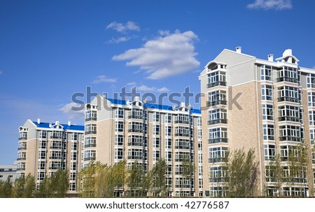new apartment buildings under clear sky. - stock photo