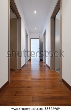 new apartment, empty corridor with open doors - stock photo