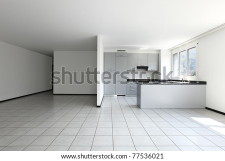 new apartment, empty room with white tiled floor - stock photo