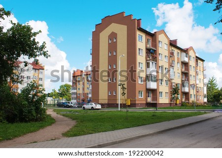 new apartment house on sunny summer day - stock photo