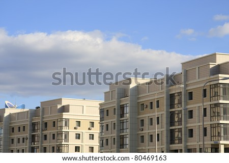 New apartment house over sky background