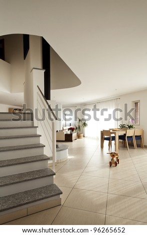 new apartment, large living room, staircase - stock photo