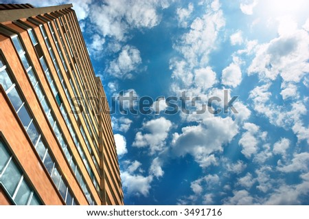 new apartments building and cloudy sky as a background - stock photo
