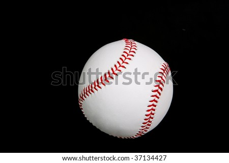 New baseball isolated on black background. Off-centered to give room for text side or top. - stock photo