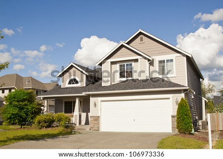 new beautiful suburban house with blue sky and clouds - stock photo