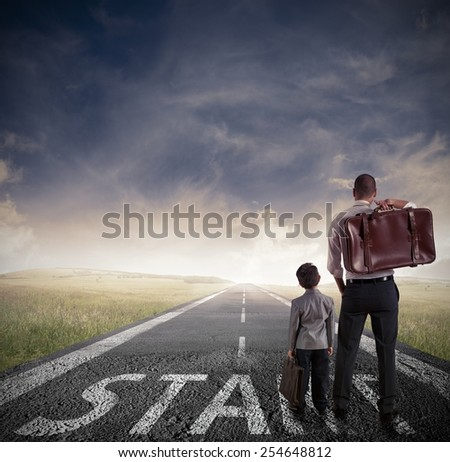 New beginning of a man and child - stock photo