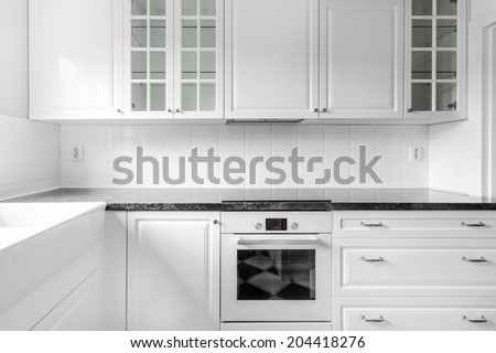 New black and white kitchen with retro details, frontal view - stock photo