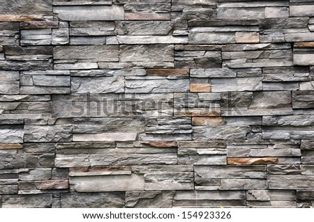 New black stone wall for background texture - stock photo