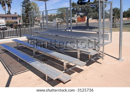 new bleachers with shade cover at sports field