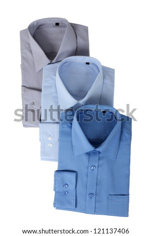 New blue man's shirts, isolated over a white background - stock photo