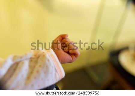 New born baby hand - stock photo