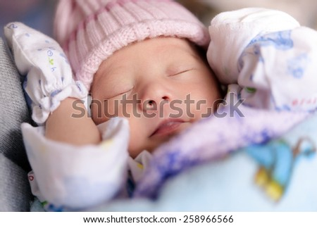 New born baby infant asleep - stock photo