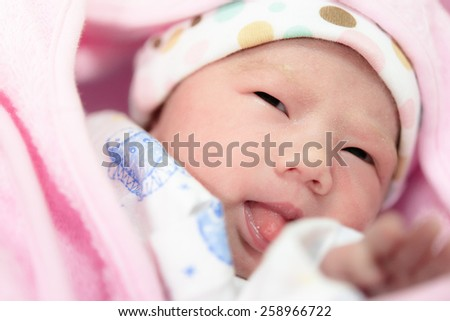 New born baby infant asleep in the blanket