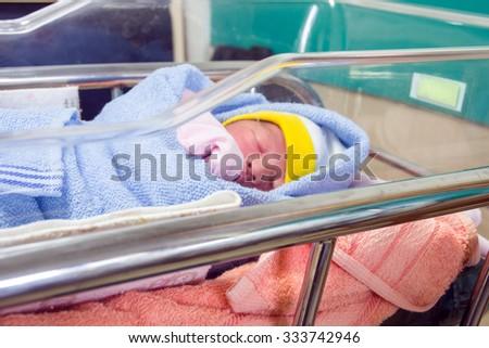new born baby on baby crib - stock photo