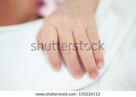 New born hand - stock photo